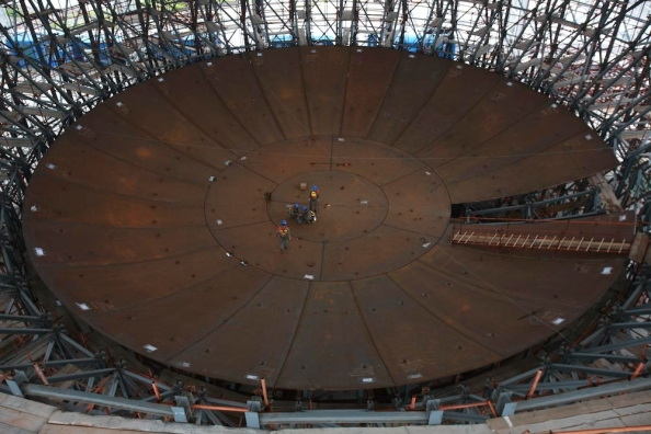 This is a large image showing the base of the containment vessel. This image was used here to show just how large the complex will be, when compared with the size of the workers. Click on the image to open in a new and larger window.