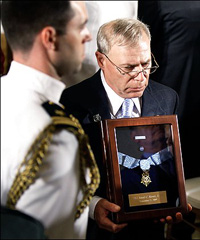 Paul Monti holds the Medal of Honor awarded posthumously to his son