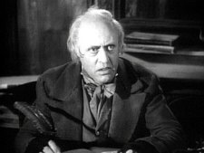 "Alastair Sim as ""Scrooge"" in the 1951 movie of the same name."