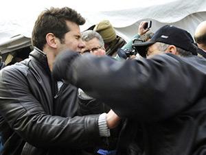 Fox News contributor Steven Crowder (left) getting slugged by a union thug