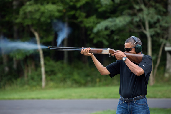 "White House caption: ""President Barack Obama shoots clay targets on the range at Camp David, Md., Saturday, Aug. 4, 2012."""
