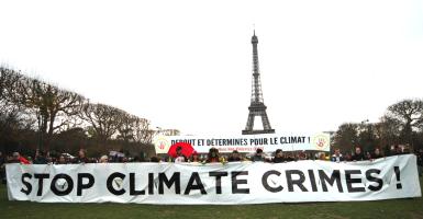 Protesters gathered near the Eiffel Tower (Photo: Joao Luiz Bulcao/Polaris/Newscom)