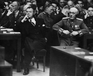 04 Oct 1946, Nuremberg, Germany --- U.S. prosecutor Robert Houghwout Jackson (left) and Russian assistant prosecutor General Uri Pokrovsky listen intently during the sum of speeches at the Palace of Justice in Nuremberg during the historic trial of 22 Nazi leaders. --- Image by © Bettmann/CORBIS