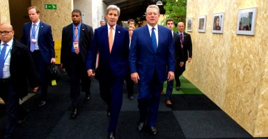 Secretary of State John Kerry walks with former Vice President Al Gore. (Photo: State Department/Sipa USA/Newscom)