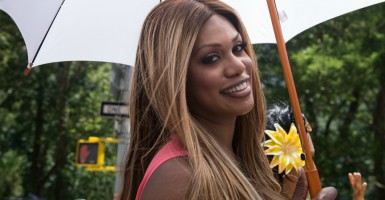"""Orange Is the New Black"" star and transgender advocate Laverne Cox participates as one of the marshals in the Gay Pride Parade in New York, N.Y., on June 29, 2014. (Photo: Stephanie Keith/Polaris/Newscom)"