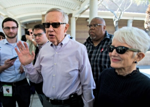Senate Minority Leader Harry Reid and his wife Landra arrive Saturday at Del Webb Middle School in Henderson, Nev., for the state's caucuses. (Photo By Bill Clark/CQ Roll Call/Newscom)