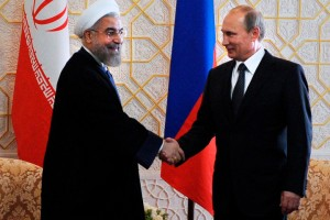 Russian President Vladimir Putin, right, and Iranian President Hassan Rouhani shake hands as they meet at the Shanghai Cooperation Organization summit in Dushanbe, Tajikistan, Friday, Sept. 12, 2014. Iran has an observer status at the  Shanghai Cooperation Organization summit. (AP Photo/RIA Novosti, Mikhail Klimentyev, Presidential Press Service)