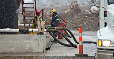 Workers unload fracking fluids from a tank truck in 2011 at an injection well in Youngstown, Ohio, where the fluids will be pumped deep underground. (Photo: Jim West/Newscom)