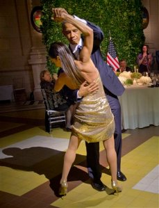 President Barack Obama dances the tango with a tango dancer during the State Dinner at the Centro Cultural Kirchner, Wednesday, March 23, 2016, in Buenos Aires, Argentina. (AP Photo/Pablo Martinez Monsivais)
