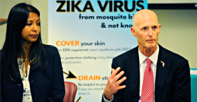 Florida Gov. Rick Scott, here with state Surgeon General Celeste Philip on June 9, 2016, has announced a total of 14 cases of people in the Miami area infected with the Zika virus by mosquitoes in the U.S. (Photo: Logan Riely/Miami Herald /TNS/Newscom)