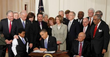President Barack Obama signing Obamacare in 2010. (Photo: Jason Reed/Reuters/Newscom)